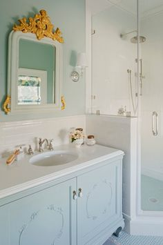 I like the subtle additions of colour. I think that a cool wallpaper behind the vanity could be fun. Blue Vanity, Eclectic, bathroom, Rethink Design Studio