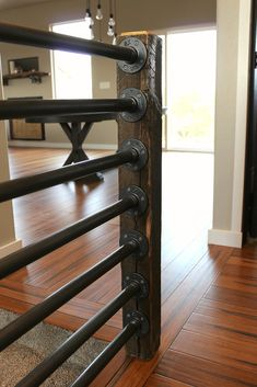 Building a beautiful rustic and industrial inspired stair banister is as simple as Use iron or black steel pipe, a unique wooden post (reclaimed) for newel post, and some fittings. Stair Newel Post, Loft Railing, Pipe Railing, Metal Stair Railing, Stair Banister, Railing Design, Banisters, Newel Posts, Railing Ideas