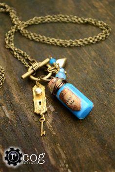 """Alice in Wonderland """"Drink Me"""" necklace"""
