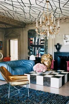Eccentric decor of contrasting colours, shapes, styles and sizes (huge gold head anyone?), love it all.  Kelly Wearstler