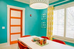 "The wall color of this turquoise + orange room is excellent. Paint color: Benjamin Moore's ""Poolside Blue"" 2048-40. House of Turquoise."