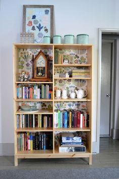 i love how she took this ikea shelf (i haven't seen this one ever- it looks like good quality actually) and made it her own.  brilliant use of a bookcase!