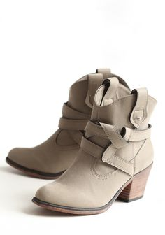 "Sayla Buckle Booties 59.99 at shopruche.com. Distinguished by a intertwined strap, these faux suede booties in taupe by Rocket Dog are perfect for every day with a faux wooden heel and Western-inspired details.All man-made materials, 2.5"" heel, 5.75"" shaft"