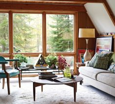 Arquitetura do Imóvel : Olha que lindo! uma cabana aconchegante integrada ao entorno.