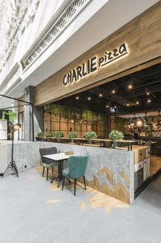 Charlie Pizza by is a new restaurant project designed by In Arch and is located in Kaunas, Lithuania. Photos by Leon Garbačauskas Restaurant Signage, Restaurant Names, Grill Restaurant, Rustic Restaurant, Cafe Exterior, Exterior Signage, Coffee Shop Design, Cafe Design, Kiosk