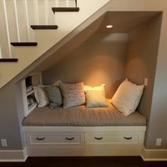 Small reading nook created in that weird space below the stairs.