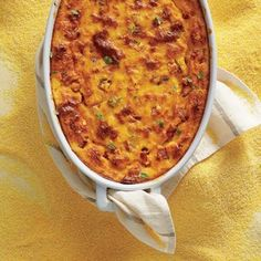 This impressive-looking casserole bakes up puffy and golden with pockets of fresh corn and savory ham. Think of it as a soufflé without...