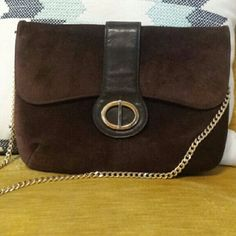 Vintage Suede Shoulder bag It has flap opening in the front.Very clean interior.Perfect condition inside and out.Genuine leather.Gold chain strap. Brand is by Susan Gail.Great for Girls night out!?? Bags