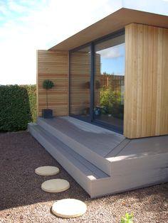 Modern garden lodge, with round stepping stones