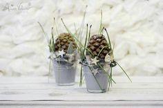 Pine cones in galvanized buckets