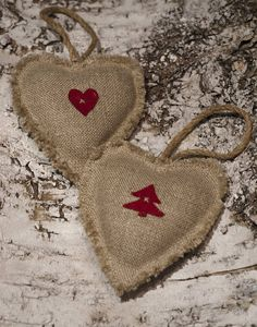 Hanging linen heart decoration.A charming rustic linen heart Christmas decoration with either a red wool heart or a tree design and finished with a natural string hanging loop. A perfect gift for Christmas guests or a festive addition to your tree or home. Handmade using natural coloured 100% linen and cranberry red wool.Handmade from 100% linen and wool, filled with polyester.Approx size 10 x 9cm