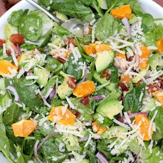 Spinach Mandarin poppy seed salad with cheese. YUM! I used turkey bacon and feta cheese and this was a huge hit. Plus, I bought poppy seed dressing to make it easier