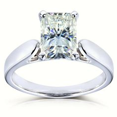 This moissanite solitaire engagement ring boasts a 7mm x 5mm or 8mm x 6mm radiant-cut moissanite center.  The 14-karat white gold positively sparkles with a highly polished finish.
