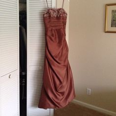 Mother of the Bride, Prom Dress Bronze satin evening dress. Lace sequin bodice. Worn once. Mother of bride. Will throw in size 8 shoes. Very flattering. A little train in back. Hard to part with this dress. Mother of Bride Dresses Strapless