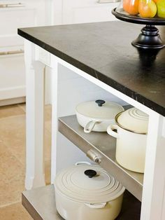 Pullout Storage. Keep frequently used pots and pans on hand with easy-to-access pullout shelves. Stainless-steel shelving offers a modern look, as well as a sturdy material for bearing the weight of heavy cast-iron cookware.