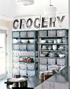Kitchen storage - shelving for plates and metal baskets.