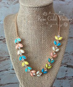 "Add a pop of color to your outfit with our Spring Leaves statement necklace! Adjustable from 19"" to 21"" in length."