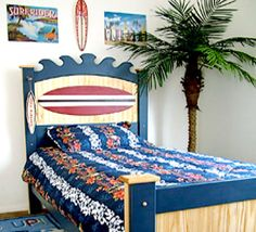 Buy a Surfboard Bed and start dreaming about the perfect wave. Our sturdy surfboard headboard makes a great addition to your kids surf bedroom or beach theme bedroom. The surfboard headboard features a surfboard with classic stripe design, a set of crashing waves, painted in navy blue paint with natural wood accents. The surfboard headboard easily mounts...
