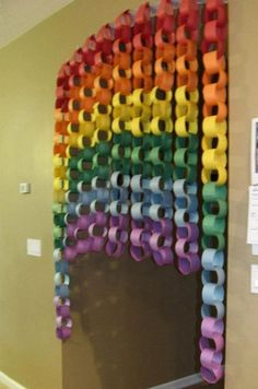 DIY Rainbow Paper Curtain. Rainbow colors are perfect for a festive event, from kids or adult birthdays to anniversaries or graduation.