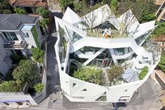 IROJE KHM's angular blooming house offers secluded outdoor living