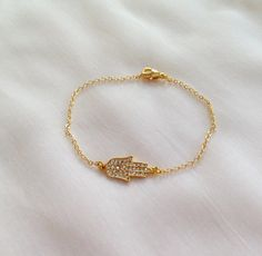 Check out this item in my Etsy shop https://www.etsy.com/listing/235416797/gold-plated-hamsa-hand-braceletgold