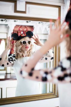 Brooke adjusts her Mickey ears in the mirrored hallway on the Mark Twain Riverboat.