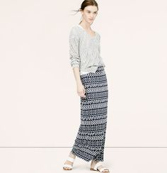 """In an irresistible array of exotic stripes, we're into the cool charisma of this soft maxi. Elasticized waist. Side slit. Lined. 34"""" long."""