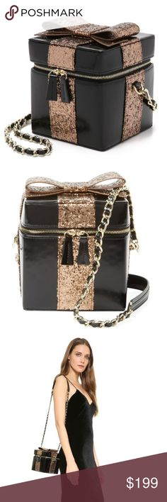 """🌟HP🌟Glitter Gift Clutch Crossbody Alice + Olivia Statement piece clutch / purse - glitter present with a bow on top! Features patent leather chain-link and detachable leather shoulder strap, so can be worn as a clutch or crossbody. Perfect for wedding, night out, and parties. Fabric lining with four flat pockets and one mirror. Body length 5"""", height 5"""", width 5"""", drop handle 19.75"""" Kate Spade whimsical style for exposure. In the process of moving, more pictures coming! kate spade Bags"""