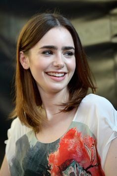 Lily Collins promoting 'Mortal Instruments.' Makeup by @Molly R. Stern.
