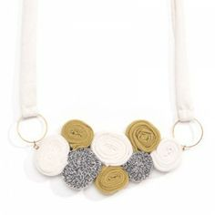 My textile necklaces are made of hand chosen fabrics and combined with plated gold pieces.Together creating a unique look. http://www.mavestore.com/product/eco-elegant-necklace