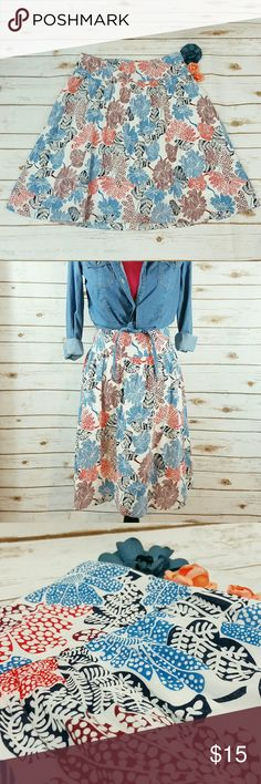"""Ambition floral skirt This cute skirt is white with a floral design that includes blue, orange, burgundy, & navy. The skirt is fully lined, and there is a half zipper on the back. The waist is approx 34"""", length is approx 24"""". All measurements taken unstretched. 100% cotton Ambition  Skirts Midi"""