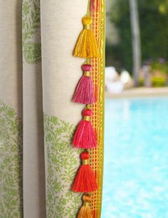 This ultra vibrant tassel hangs perfectly on drapes. Mosaics Collection by BRIMAR. #brimar #trim  #tassel fringe
