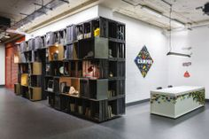 google campus :: reclaimed fruit crates, mdf and metal box shelving