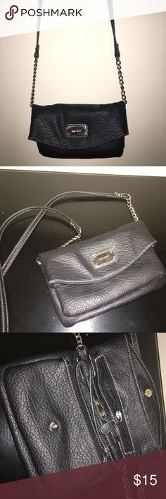 CUTE CROSS BODY PURSE Nine West gently worn purse! Can be converted from a crossbody bag to a clutch by removing the strap easily! Multiple pockets to hold an array of things & leather material that is sturdy. I loved taking the purse out & daily, it holds alot! Nine West Bags Crossbody Bags