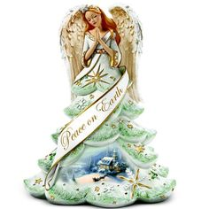 Thomas Kinkade Jeweled Christmas Angel Of Peace Figurine by The Bradford Exchange Bradford Exchange    http://www.amazon.com/dp/B002SV1J7W/ref=cm_sw_r_pi_dp_NEwvub0ABQPY4