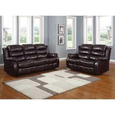 Smithee Double Reclining Sofa and Loveseat , Polished Microfiber | Channel tufted polished microfiber covers the Smithee Collection. The transitional style is appropriate in a number of casual living room settings. Overstuffed for your comfort, the seating group features a quick release reclining mechanism that stretches to provide you a relaxing experience.