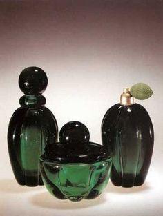 Vintage bottles of green glass perfume