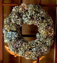 dried hydrangea wreath on French door