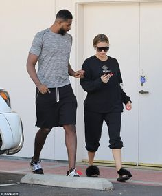 Laid back: Her Cleveland Cavaliers basketball player beau was set up in casual gear as well as he rocked a simple grey tee and black shorts