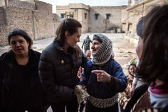 """"""" UNHCR Special Envoy Angelina Jolie meets displaced Iraqis who are members of the minority Christian community, living at an abandoned school in Al Qosh, Iraq, on January Originally from. Jolie Pitt, Le Jolie, Brad Pitt, Angelina Jolie 2016, John Kerry, Christian Families, Play Soccer, Hollywood Star, School"""