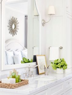 Bathroom countertop tray. A white and gray bathroom features separate washstands topped with polished marble fitted with…