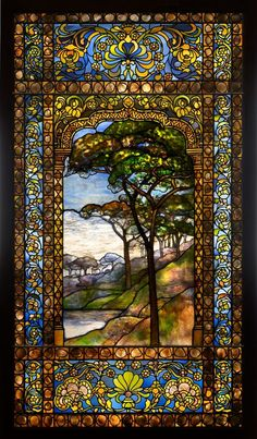 Tiffany Studios (American, est. 1902). Landscape window, 1893-1920. Leaded glass and pebbles, 80 x 44 ½ in. Photograph by John Faier, © The Richard H. Driehaus Museum.