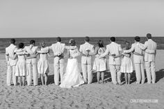 Wedding party taking in the view of the ocean.  Photo by Carley Rehberg Photography www.engagingeventsobx.com #beachwedding #engagingeventsobx
