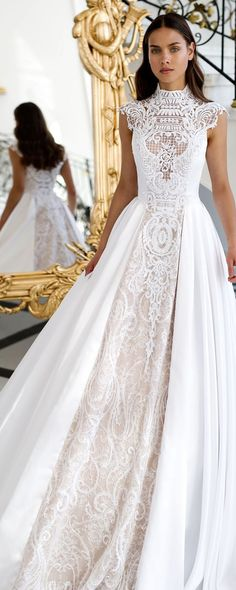 Warrior Princess: There's something exotic about the lace collar neckline and structure of this romantic wedding dress. Something that would've been worn by a warrior princess, it's the perfect fit for a boho bride who's wild at heart.