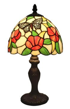 An elegant pattern floral from this classic Amora Lighting table lamp that instantly brings refinement to any room. This colorful Amora Lighting Tiffany-style table lamp features a pull chain and 142 detailed, bright glass pieces. With a circular dark bro Butterfly Table, Glass Butterfly, Butterfly Design, Tiffany Style Table Lamps, Tiffany Lamps, Buffet Table Lamps, Stained Glass Flowers, Mellow Yellow, Lighting