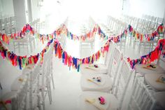 Rainbow Garland Aisle Runner     Create a whimsical rainbow effect by stringing ceremony aisles with colourful neon garlands.     Photography by  Weddings by Two . Image via  Brooklyn Bride .