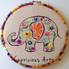 8 hoop, hand embroidered colorful garden elephant on canvas. Single and double thread embroidered. Done with a variety of threads & stitches. Wrapped in a beautiful silk yarn and finished off in the back with a pretty fabric and matching cording. Hand Embroidery Stitches, Embroidery Hoop Art, Hand Embroidery Designs, Embroidery Techniques, Embroidery Applique, Cross Stitch Embroidery, Embroidery Patterns, Band Kunst, Needlework