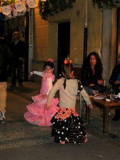 cdbdd06c5e0 Young girls dancing Sevillana in the streets during Dia de la Cruz in  Granada