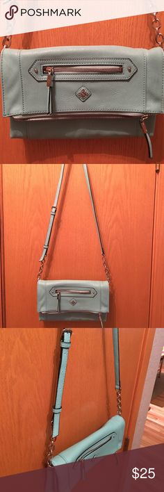 """Vera Wang Foldover Crossbody Bag Vera Wang Teal Foldover Crossbody Bag Length: 10.5"""" Height: 7.5"""" when folded over - 12"""" when opened fully Width: 2.25"""" Material: Outer 100% PU - Interior Lining 100% Poly Features: Bi-Fold Closure w/ Magnetic Snap, Front Exterior Zip Pocket, When Opened Top has a Large pouch with Zip top closure, 2 Sides to the Interior - rear has an inner zip pocket, front has a large pouch pocket, interior is lined w/ Vera Wang Printed material, Adjustable Crossbody Strap…"""
