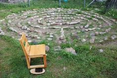 """Meditative labyrinth outside: """"The Montessori Prepared Environment""""    The outside environment needs to be prepared in just as thoughtful of a manner as the indoor classroom. Here you notice our sand-filled labyrinth, equipped with a small chair where the child sits to remove his shoes and socks. After he walks the labyrinth, he sits back down and brushes off his feet with the little brush."""""""